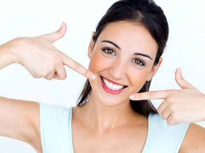 woman pointing at her white smile