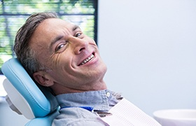 Man sitting in dentist's chair smiling