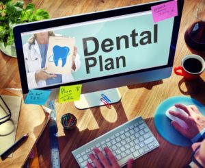 person looking at dental plan on a computer