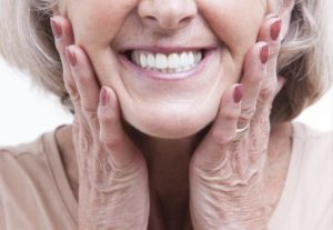 woman with dentures in new bedford